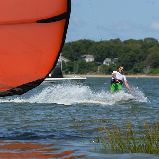 George I. Pare' of True Progression Kiteboarding riding a custom color 2014 Ozone Zephyr on Cape Cod in light wind.